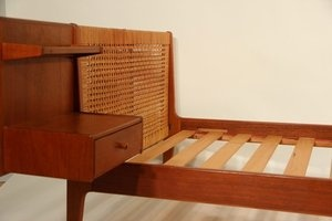Hans J Wegner bed with wicker headboards and bedside table.