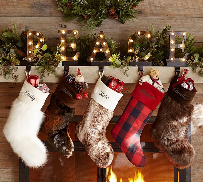 letters on the mantel. Lit Bronze Word Stocking Holder - Peace