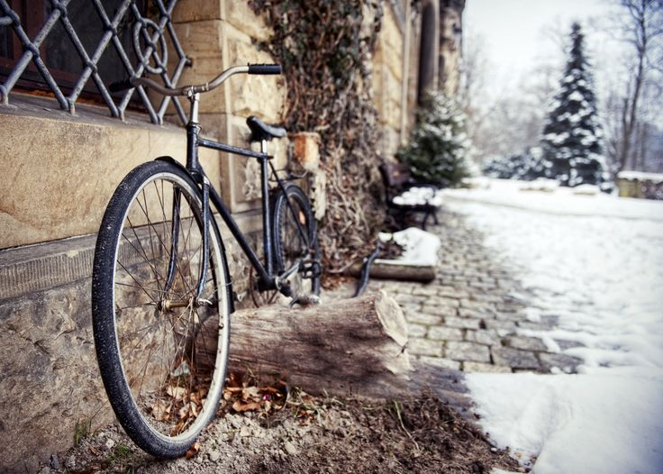Bicycle parked near the snow at Kliczkow Castle. Lower Silesia, Poland.