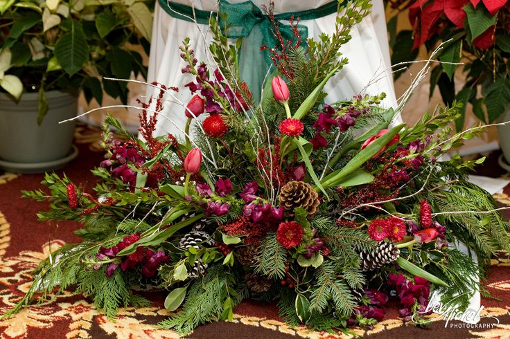 A winter arrangement for Stacey and Tom's December wedding at White Clay Creek Country Club.
