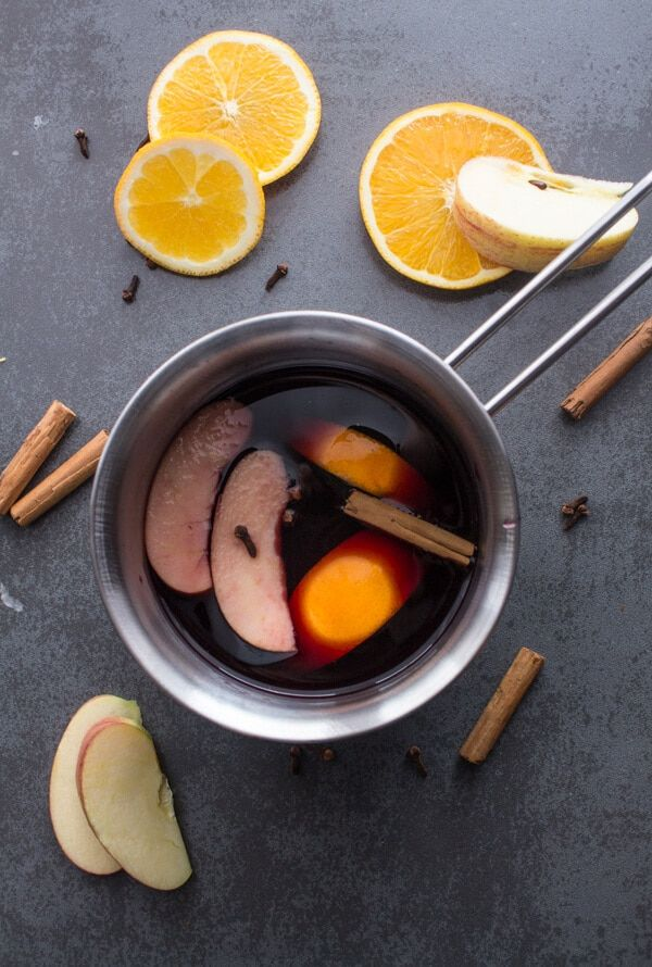 Easy Mulled Wine Recipe - Easy Mulled Wine Recipe,red wine simmered with slices of orange, apple, cinnamon, cloves, fig and honey.A delicious simple feel better drink.