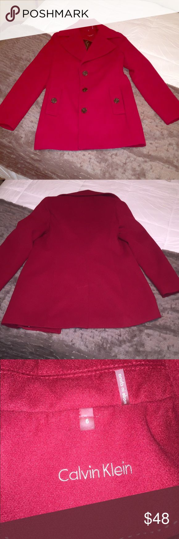 Calvin Klein red pea coat with black buttons Calvin Klein red pea coat with black buttons. Size 6. Calvin Klein Jackets & Coats Pea Coats