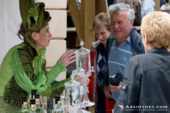 Gaudentia (from the Gaudentia Persoz distillery) at the Fête de l'Absinthe 2011. Here she is explaining how to use an absinthe fountain.