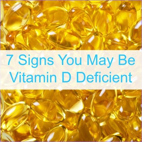 """A background of Vitamin D pills with the words """"7 Signs You May Be Vitamin D Deficient"""""""