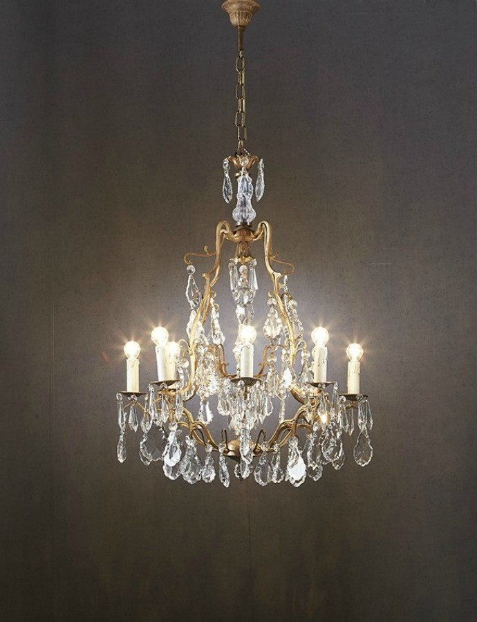 Linogues Chandelier  The Linogues Chandelier is a delicate chandelier that features a finely worked antique bronze frame. The frame is literally dripping with detailed teardrop shaped faux crystal that are complemented by smaller round pieces. The Linogues is an eight light chandelier with faux candle fittings for the globes.