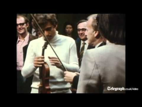 Yehudi Menuhin the American-born British violinist playing a Stradivarius before it is auctioned at Sotheby's 1971