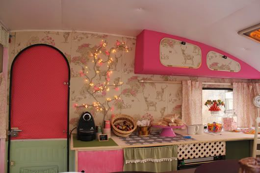 Pink and wallpaper inside a vintage retro shasta camper makeover