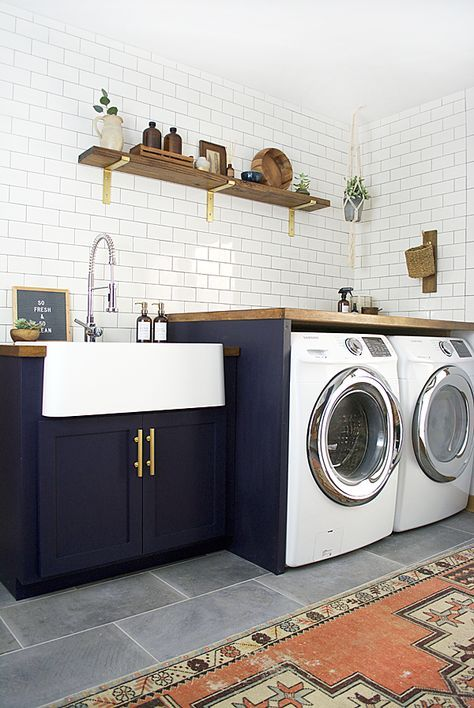 A dated space gets a dramatic update. Check out this Modern Navy Laundry and Mud Room Reveal!