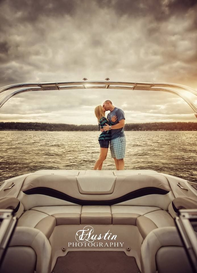 Engagement photo on a boat at sunset on Lake Sammamish in Issaquah, WA | TAustin Photography