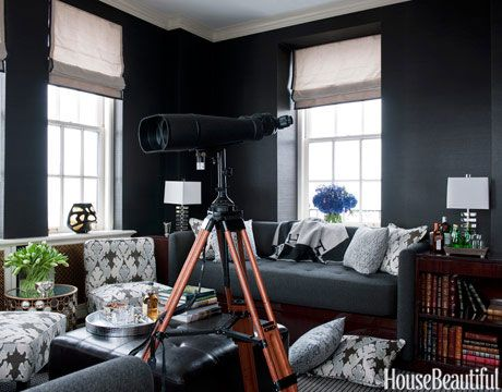 Big, beautiful, black...but done with texture.  The walls are a deep charcoal grasscloth paper and the sofas are a beautiful woollen grey.