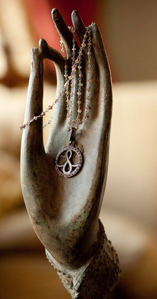 pendant symbolic of the Buddhist 8-fold path and the 8 limbs of yoga