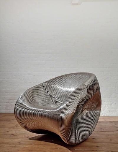 Solid Rocker (2010) / designed by Ron Arad #livingroomchairs  #diningroomchairs #chairdesign upholstered dining chairs, silver chair, upholstered chairs | See more at http://modernchairs.eu