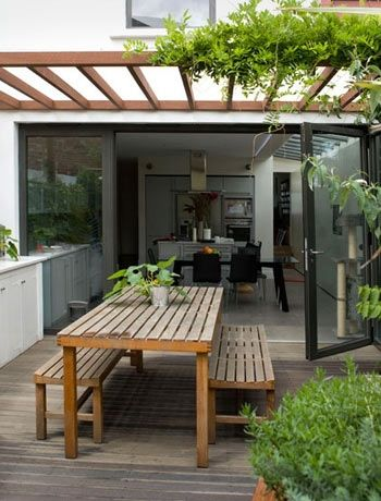 Alfresco dining area - i like the three piece simple table/chairs
