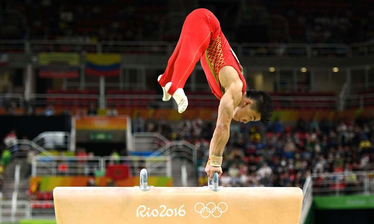 Chaopan Lin of China competes on the pommel horse during the men's artistic individual all-around finals in the Rio 2016 Summer Olympic Games at Rio Olympic Arena.