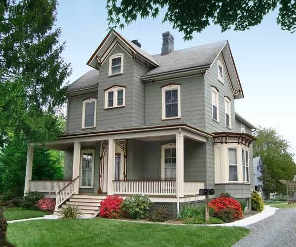 To make a house look grounded, paint the foundation a shade darker than the siding.