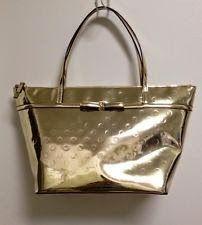 Tas Kate Spade Camelia Street Sophie-Gold  Deskripsi Bahan: Dilapisi Luxury Vinyl Exterior di Adorable Dots-embossed Glossy Gold Depan: Kate...