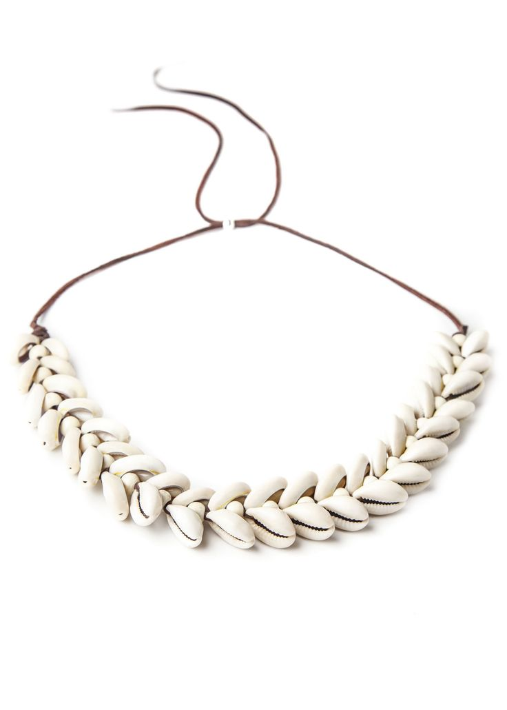 Like a lei made from cowrie shells, this necklace welcomes the sunshine season! Soft leather lace features white wood beads and shells woven throughout. It has an adjustable sliding bead back, so it can be worn as an amazing statement choker, or whatever your desired length is.