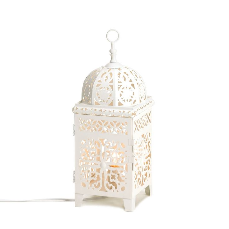 Fill your room with gorgeous light! This electrical lamp will cast fantastic shapes and shadows across your room from the light of a single bulb. Switch it on and enjoy the intricate pattern of the white metal frame's cutouts.
