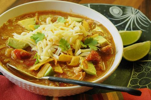This is the BEST tortilla soup recipe ever.  I do not love Mexican Food, but I love this recipe, and everyone I have made it for does too.  I will tell you though, I rerely fry my own tortilla strips.  We use chips.  :)  OH!  Do you know what I found out recently?!?  If you ask them at the Costco meat counter, they will sell you two and 1/2 pounds of shredded rotisserie breast meat chicken for about 10 bucks.  Fabulous.