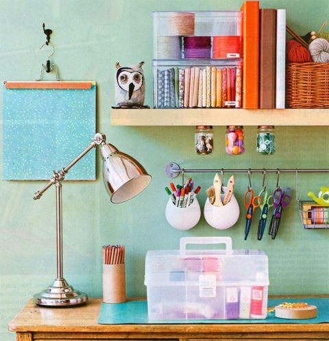 office craft room organization. baby food jars and Ikea storage rod.