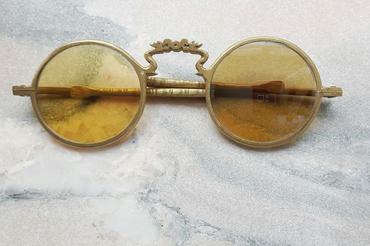 RARE ANTIQUE SUNGLASSES RULED BY WOLVES