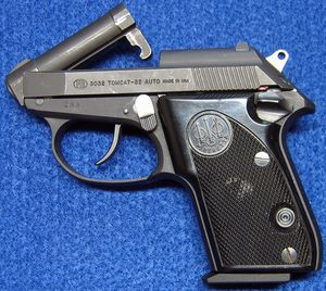 Left side of Beretta 3032 Tomcat 32 ACP semi-auto pistol, with the barrel tipped up (opened). - Photo © Russ Chastain