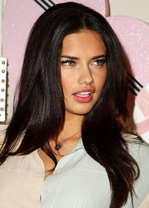 Victoria's Secret model Adriana Lima looks sultry and striking with her glossy, ebony brown locks. This nearly-black hair color is rich and striking, and it suits all complexions. Ask your stylist for a glossing wash after your color treatment for a long-lasting shine.