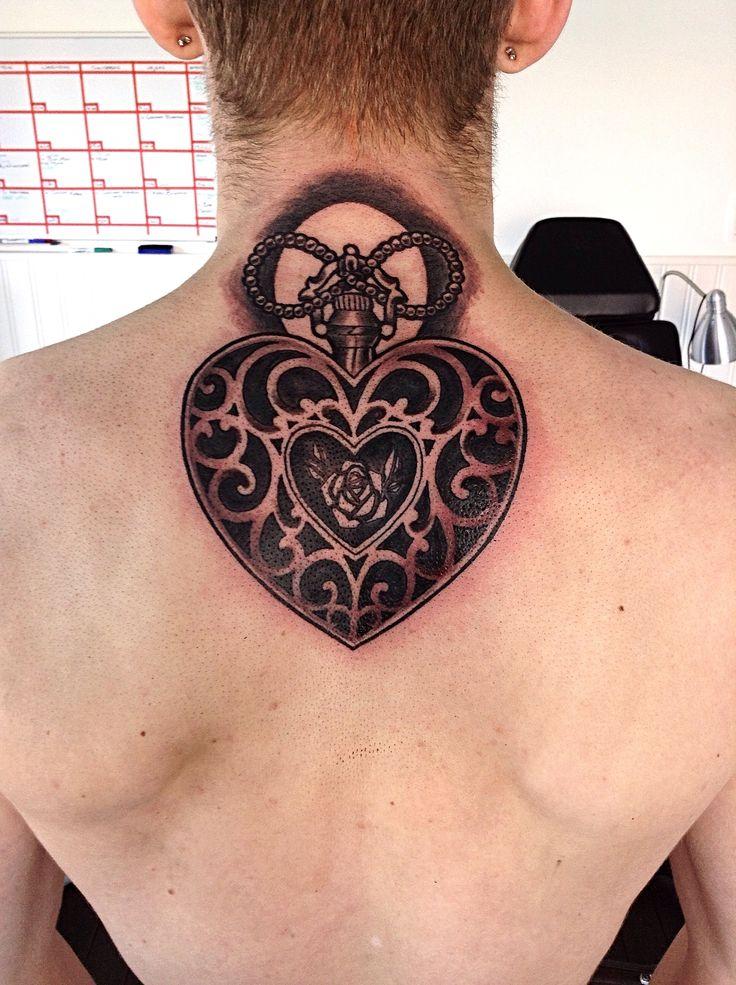 Heart locket tattoo by @tattoo.nina.noa
