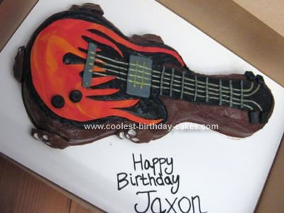 Homemade Electric Guitar Birthday Cake: I had a mom request an Electric Guitar Birthday Cake  with flames and skulls. I couldn't find one that had been done online, so I took most of my inspiration