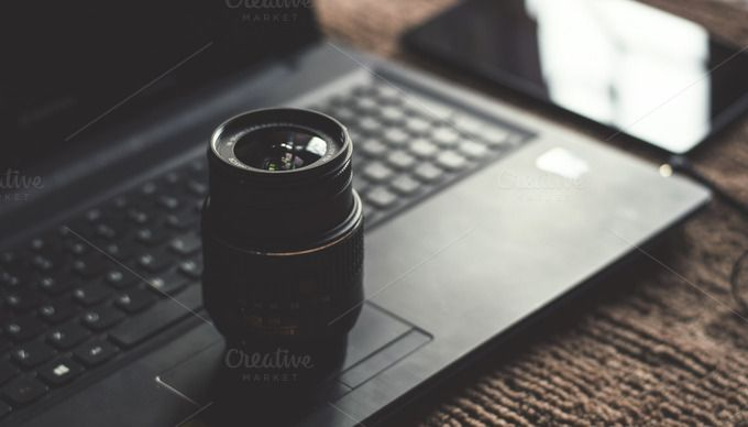 Check out Camera Lens on Laptop by Shots By RC on Creative Market