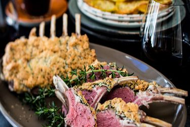 Herb souffle lamb racks with mulled wine sauce