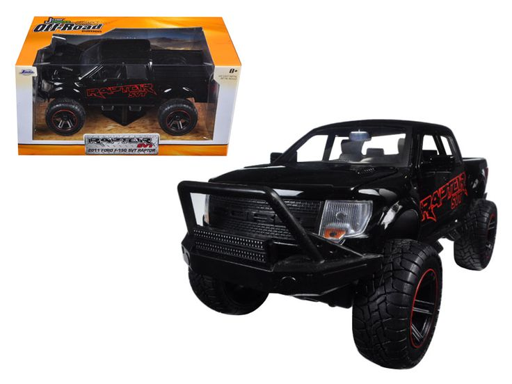 2011 Ford F-150 SVT Raptor Black/Red Pickup Truck Off Road 1/24 Diecast Model by Jada - Brand new 1:24 scale diecast model car of 2011 Ford F-150 SVT Raptor Black/Red Pickup Truck Off Road die cast car model by Jada. Rubber tires. Brand new box. Comes in a window box. Detailed interior, exterior. Has opening doors, hood and rear gate. Made of diecast with some plastic parts. Dimensions approximately L-8.5, W-4.25, H-4.75 inches. Please note that manufacturer may change packing box at…
