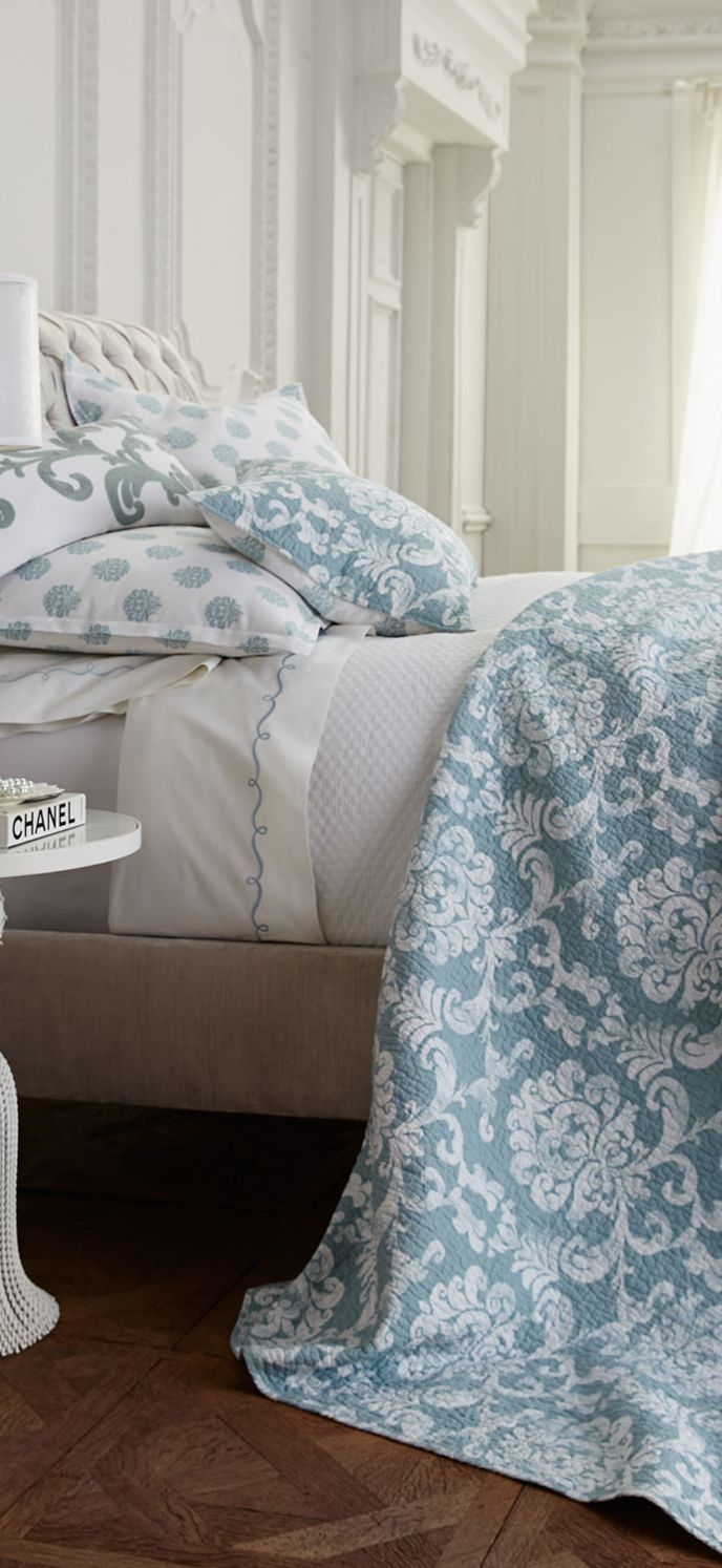 Providence Luxury Bedding Collection - in a solid white room with wood floors