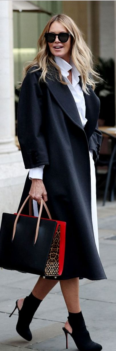 Who made  Elle Macpherson's red handbag, black suede boots, and white shirt dress?