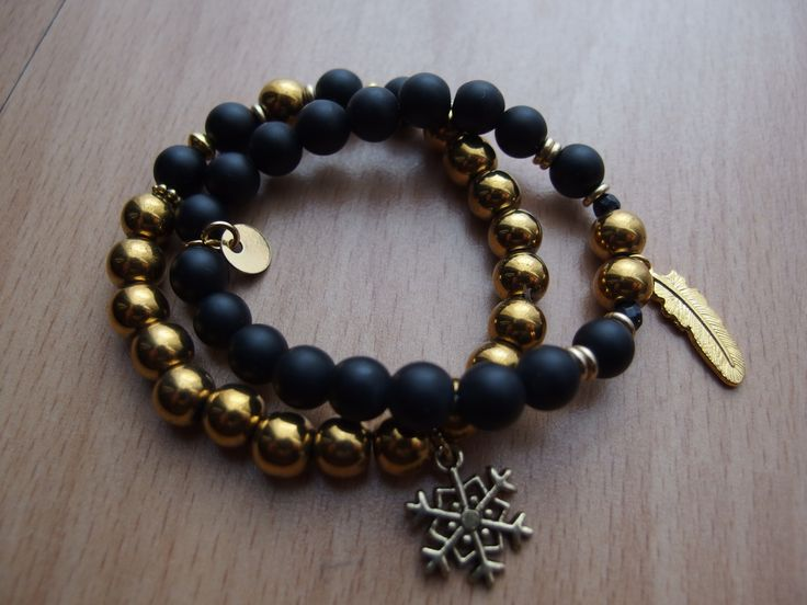 gold hematite, black stone