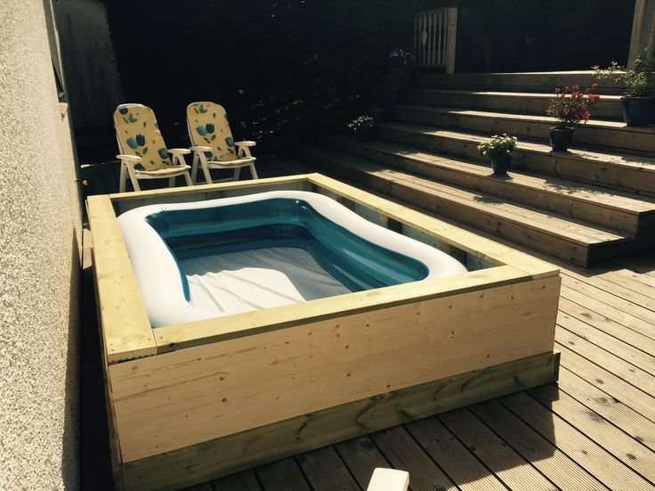 Home made hot tub from large paddling pool, deck boards and cladding. Fills from hot/cold water tap so you can have the temperature just the way you like it.