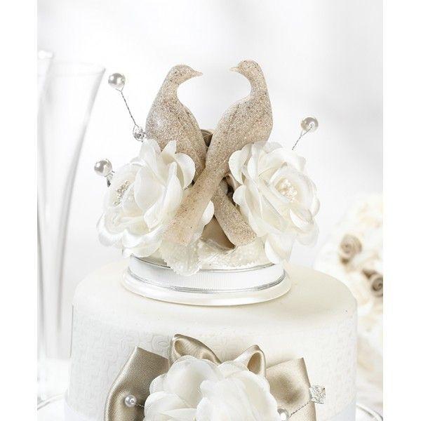 Questo elegante Cake Topper dispone di una coppia di colombe che condividono uno  sguardo amorevole. Le colombe sono in resina con finitura in finta pietra per un  tocco originale ed elegante. Di seguito alle colombe vi sono una serie di perle,  così come i fiori nei colori del tortora e dell'avorio. La base di resina di colore  bianco ha il fondo piatto per facilitare il posizionamento sulla torta nuziale.  Misure:12,7 x 8,9 cm