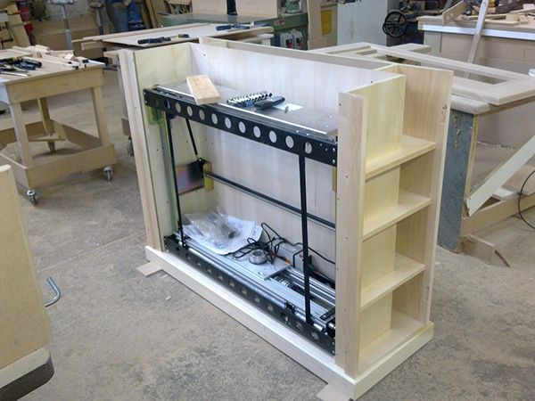 TV lift in a false chest of drawers.