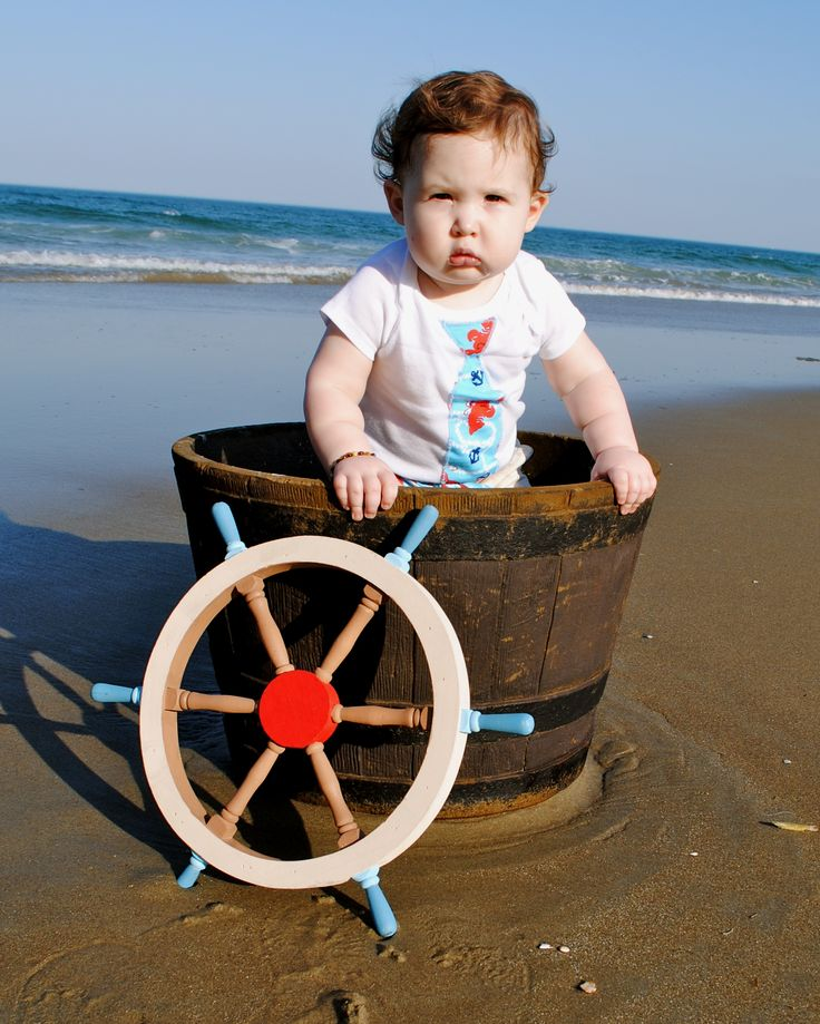 Kal's 1st birthday photo-shoot at the beach! Nautical/boat themed!  fabric used for tie: http://www.ebay.com/itm/BonEful-Fabric-FQ-Cotton-KNIT-Red-White-Blue-Child-Anchor-Nautical-Rope-Lobster-/230901608038?pt=US_Fabric=item35c2ceee66