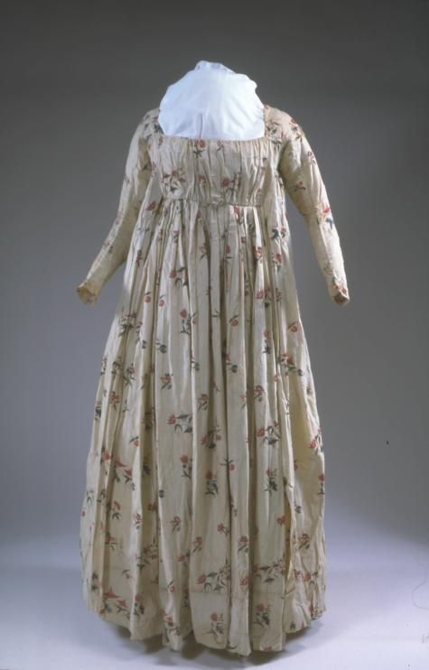 Printed cotton dress (front), probably American (fabric made in India or England), 1790s. This gown, with its open robe and matching petticoat, is a product of the revival of Greek design in fashionable architecture, furniture, and clothing. The gown shown here opens in the front, which is not as common as back closures.