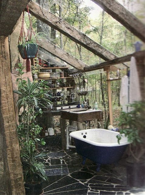 Bathroom in a wooden conservatory originally found here: http://earth-age.blogspot.com/