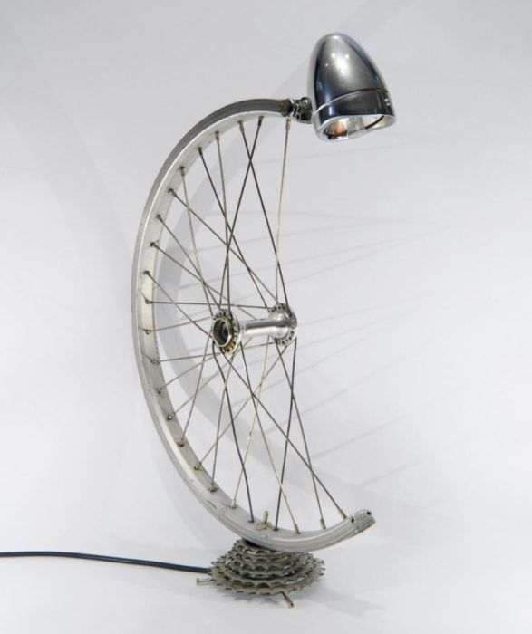 Besospoke Bicycle Desk Lamp     Be eco-friendly and re-use an old bicycle tire to make a cool looking lamp. This is a unique desk lamp.