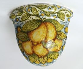 """Angular conical wicker basket """"fruit and flowers"""" """"Gerla"""" conical wicker basket angular in majolica made and hand painted. Belonging to the line """"Fruits and Flowers"""" and is available with decorum lemons (1) and decorated with pomegranates and sunflowers (2). Ideal both as a vase holder and as appliqu. #artigianato #madeinitaly #gerla #ceramica #ceramic #oggettistica #craftobject"""