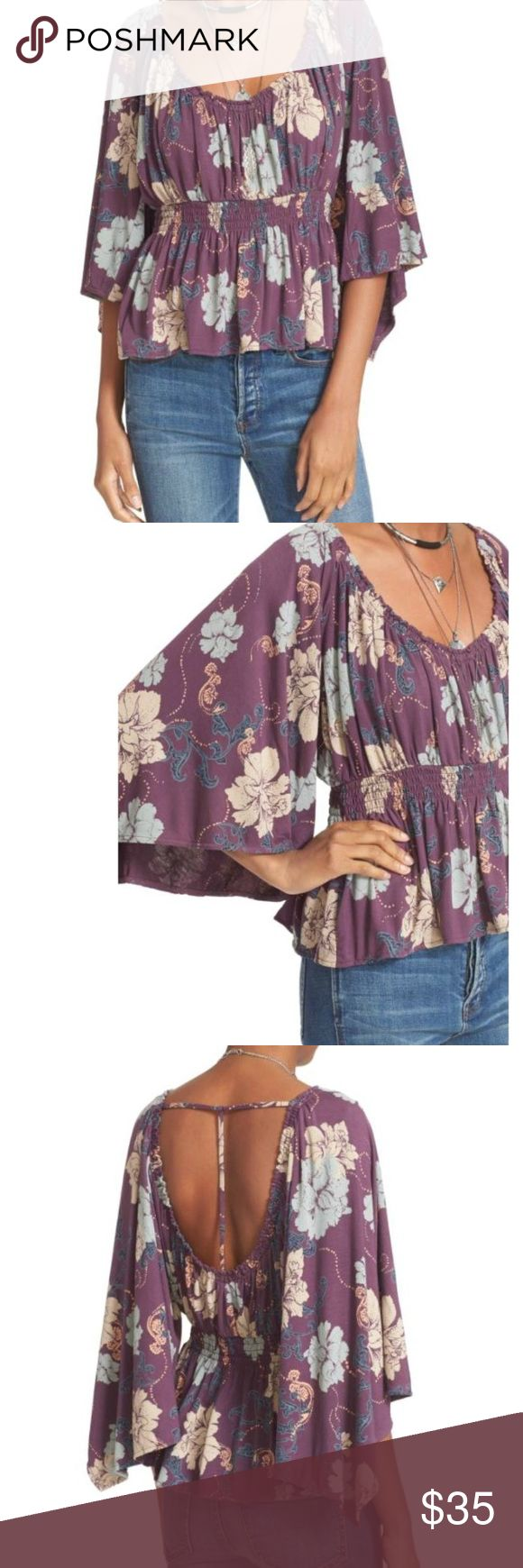 """NWT Free People Glenside Top. XS Brand New!  -Fits true to size, order your normal size -Designed for a loose fit -Scoop neck and back, three-quarter wide sleeves -Pointed cuffs, elasticized smocked empire waist -T-strap back, allover floral print -Approx. 22"""" from back of neck to hem Free People Tops"""