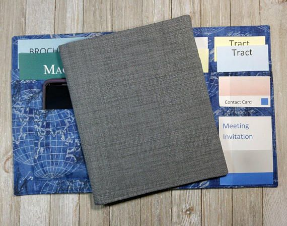 Grey literature organizer with pockets for meeting invitations