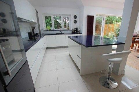 White island kitchen design with blackberry design glass