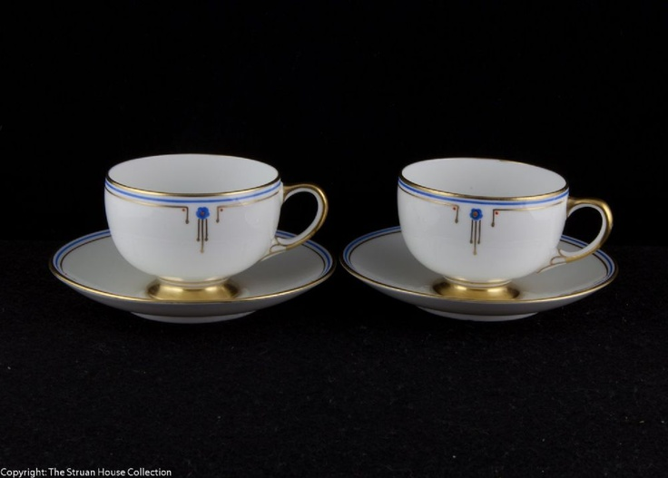 Perfect for the lovers of Art Deco design A beautifully crisp pair of white coffee cups and saucers on gilded pedestals with gilded rims and handles