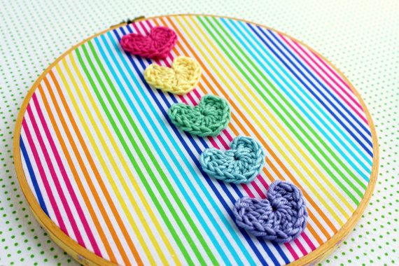 bright rainbow stripe vintage embroidery hoop art - with crocheted hearts. via Etsy.
