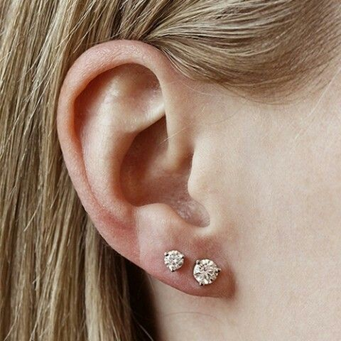 Double ear piercing with diamonds studs
