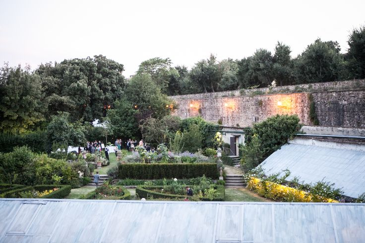 The greenhouse surrounded by a magnificent Italian garden and the Medieval walls of Florence.